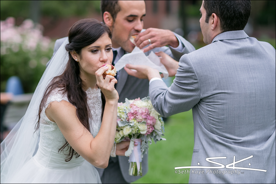 bride and groom with hotdogs