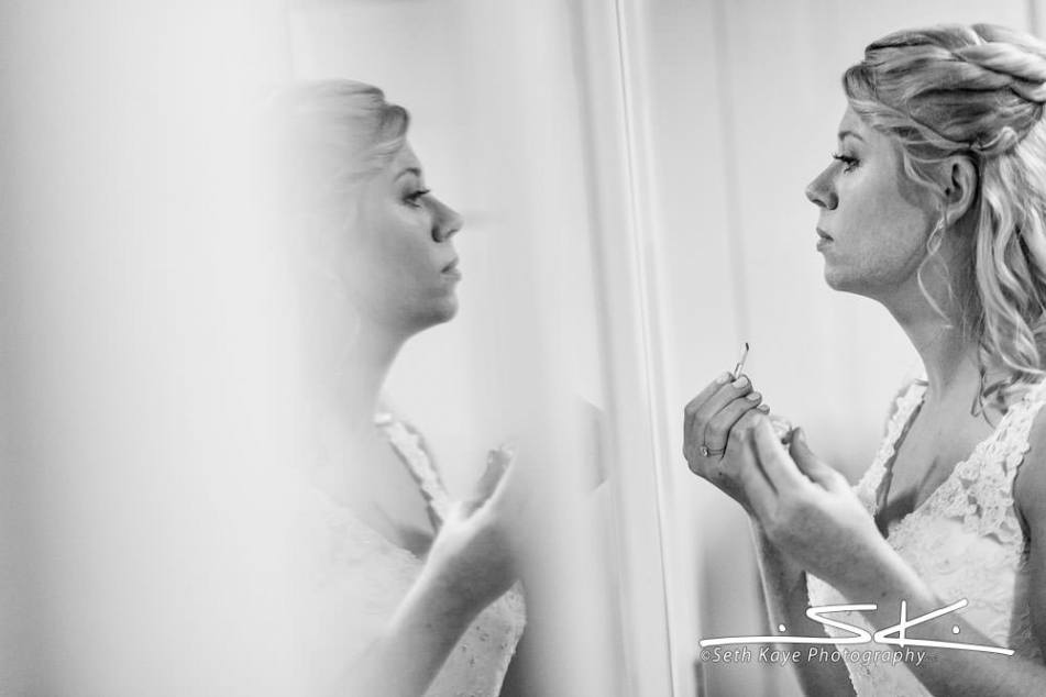 bride checking her makeup before the ceremony