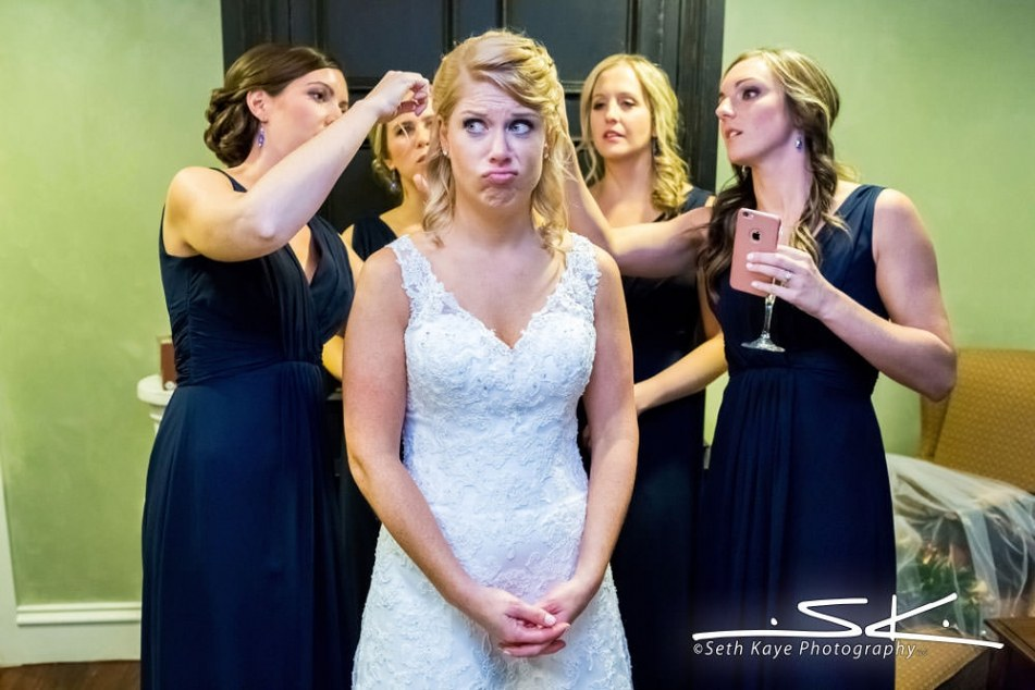 bride making a funny face with her bridesmaids