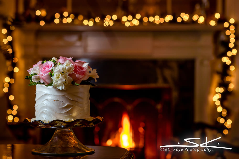 wedding cake in front of a fireplace